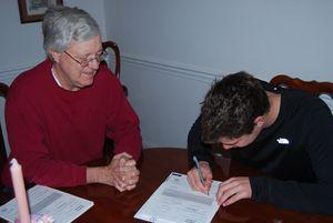 Matt Signing at Home for IU 001